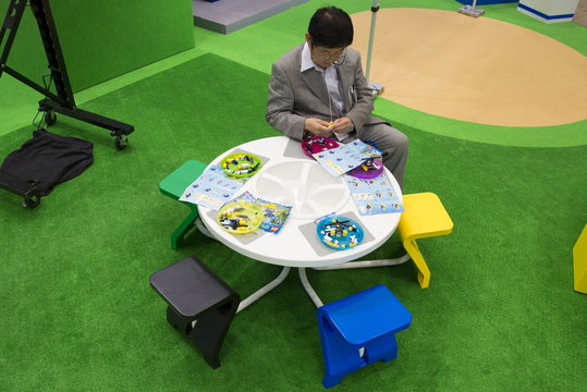 A man holds Lego pieces at the Tokyo Toy Show trade fair in Tokyo