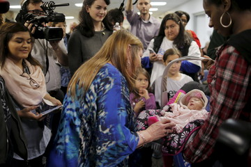 Jane Sanders, wife of U.S. Democratic presidential candidate Senator Bernie Sanders, reacts to a baby in the audience at an education forum in Columbia, South Carolina