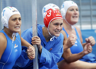 Players from Italy's woman water polo team react during their European Water Polo Championships bronze medal match against the Netherlands in Zagreb