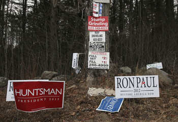 Campaign signs for Republican presidential candidates are seen on the side of the road in Northfield, New Hampshire