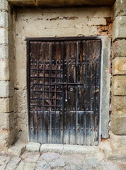 Old medieval door in the alcazaba of Badajoz, Spain