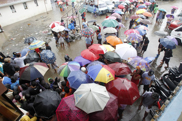 Residents displaced by the flooding caused by monsoon rains and intensified by tropical storm Trami wait in line to receive relief goods in Noveleta Town, Cavite City