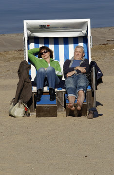People sit in a beach chair during the opening day of Berlin's Wannsee lido