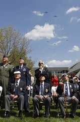 Three of the last five survivors of the Doolittle Toyko Raid watch a flyover of B-25 aircraft in Dayton