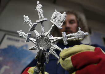 Maker of toy soldiers Timur Zamilov works on his new collection at a workshop in Moscow