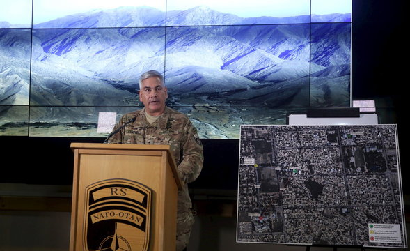 U.S. Army General John Campbell, the commander of international and U.S. forces in Afghanistan, speaks beside a Kunduz city map during a news conference at Resolute Support headquarters in Kabul