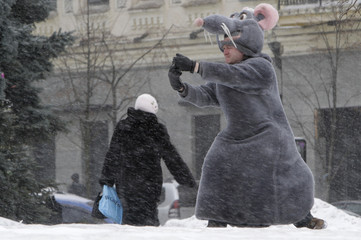 A man dressed in a rat costume takes picture in central Kiev