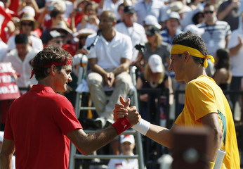 Federer of Switzerland acknowledges Tomic of Australia after their Davis Cup World Group play-off tennis match in Sydney