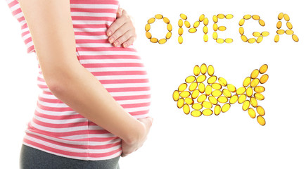 Closeup view of pregnant woman touching belly on white background