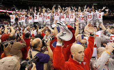 Ohio State University players celebrate after their team defeated the University of Arkansas during the NCAA BCS Allstate Sugar Bowl football game in New Orleans