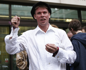 File photo of Lauri Love reacting as he leaves after attending his extradition hearing at Westminster Magistrates' Court in London