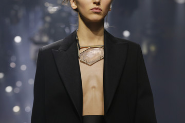 File picture of a model who presents a creation by Israeli-American designer Alber Elbaz as part of his Autumn/Winter 2015/2016 women's ready-to-wear collection for fashion house Lanvin during Paris Fashion Week