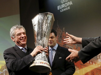 UEFA Vice-President Villar Llona gives the trophy to Wessels, State Councillor of Basel City after the draw of Europa League semi finals in Nyon