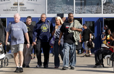 Fiat Chrysler Autos assembly workers leave the Fiat Chrysler Automobiles Warren Truck Assembly plant during a work shift change in Warren, Michigan
