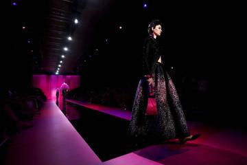 A model presents a creation by Italian designer Giorgio Armani as part of his Haute Couture Fall Winter 2015/2016 fashion show for Giorgio Armani Prive in Paris