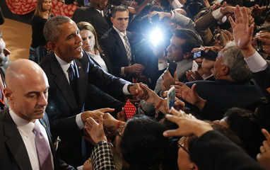 U.S. President Obama shakes hands with the crowd after delivering a speech at Siri Fort Auditorium in New Delhi