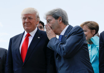 Trump listens to Italian PM Gentiloni during family photo at the G7 Summit expanded session in Taormina