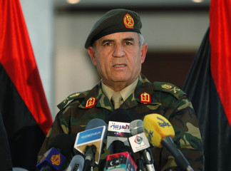 Yousef al-Manqoush, chief of staff of the Libyan Armed Forces, speaks at a news conference at the NTC headquarters in Tripoli