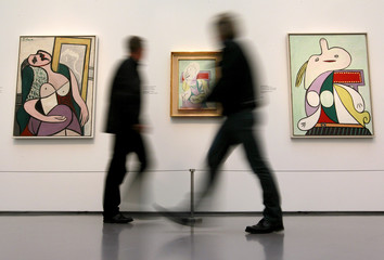 Visitors walk past paintings by late Spanish artist Picasso during a media preview at the Kunsthaus Zurich in Zurich