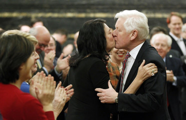 Interim Liberal leader Rae kisses his wife Arlene Perly Rae prior to giving a speech during a caucus meeting in Ottawa