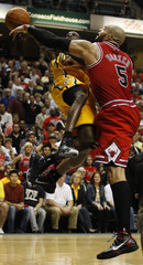 The Bulls' Boozer fouls the Pacers' Collison during an NBA playoff basketball game in Indianapolis