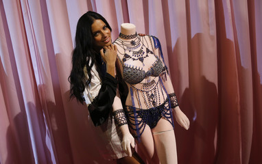 Model Adriana Lima poses for a photograph with a 'Dream Angels Fantasy Bra' ahead of the 2014 Victoria's Secret Fashion Show in London