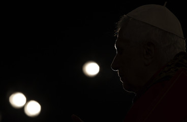 Pope Benedict XVI leads a Via Crucis procession during Good Friday celebrations in front of the Colosseum in Rome