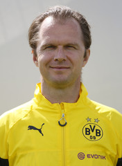 Borussia Dortmund's doctor Braun poses for an official photo in Dortmund