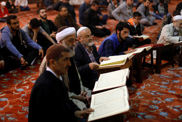 People read the Koran on the first day of the fasting month of Ramadan in Istanbul