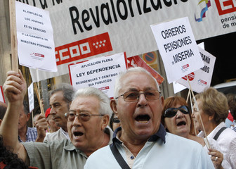 Pensioners protest against pensions being frozen in front of the Economy ministry in Madrid