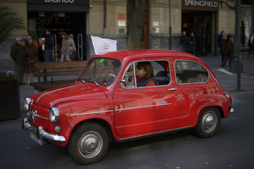A member of a Seat 600 owners club drives along Bilbao's Gran Via during a rally