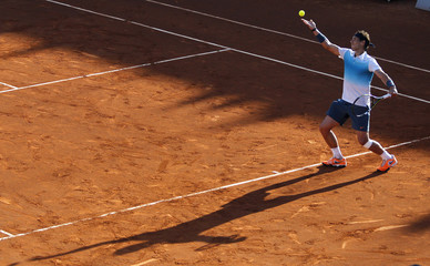 Nadal of Spain serves during men's doubles tennis match at the Chilean Open tennis tournament in Vina del Mar city