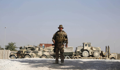 A German armed forces Bundeswehr soldier stands guard at his base in Kunduz