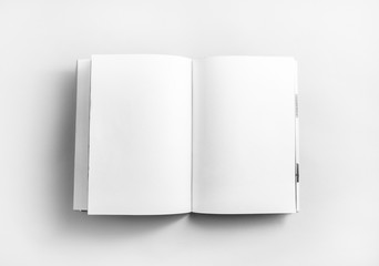 Blank open book, brochure or magazine on paper background. Mock-up for graphic designers portfolios. Responsive design mockup. Top view.
