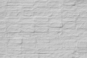 Whitewash  painted old brick wall  with plaster texture. Background  for text or image.