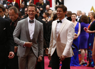 Host Neil Patrick Harris arrives with husband David Burtka at the 87th Academy Awards in Hollywood, California