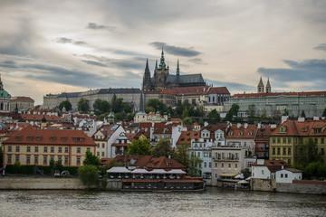 Colorful Prague gothic Castle above the River Vltava with Charles Bridge after Sunset, Czech Republic