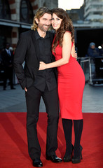 "Sharlto Copley poses with Tanit Phoenix as they arrive for the gala screening of the film ""Free Fire"", during the 60th British Film Institute (BFI) London Film Festival at Leicester Square in London"