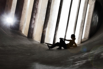Sportive Women running in an Old Windtunnel: She is Taking a break and is Relaxing
