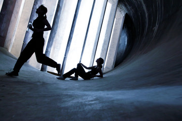 Sportive Women running in an Old Windtunnel, Healthy Lifestyle Concept