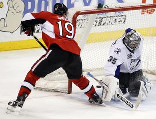 Ottawa Senators' Jason Spezza puts the game-winning goal between the legs of Tampa Bay Lightnings' goalie Dwayne Roloson in overtime during their NHL game in Ottawa