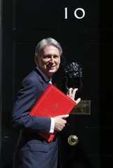 Foreign Secretary Philip Hammond arrives for Britain's Prime Minister David Cameron's first cabinet meeting at 10 Downing Street, in Westminster, London