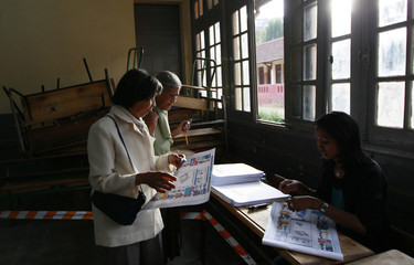 Voters are processed before casting their votes at a polling centre in the capital Antananarivo