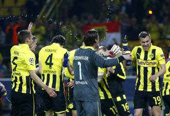 Borussia Dortmund players celebrate defeating Real Madrid in Champions League semi-final first leg soccer match in Dortmund