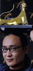 """Director Li Hongqi poses during a photocall for his film """"HAN JIA (Winter vacation)""""  at the 63rd Locarno International Film Festival"""