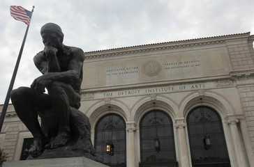 A statue of 'The Thinker' by sculptor Aguste Rodin is seen in front of the Detroit Institute of Arts museum along Woodward Avenue on  Detroit,