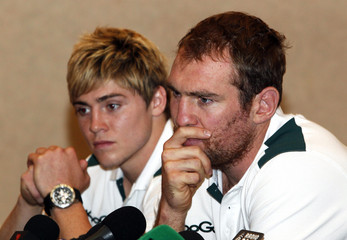 Australia Wallabies' Rocky Elsom puts his hand over his mouth next to James O'Connor during a news conference in Auckland