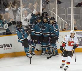 San Jose Sharks Malhotra celebrates his goal with teammates as Calgary Flames Conroy skates away in San Jose