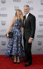 Actress Rebecca Gayheart and her husband actor Eric Dane pose at the American Film Institute's 43rd Life Achievement Award Gala honoring actor Steve Martin in Los Angeles