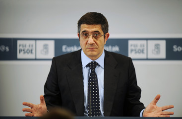 Basque regional premier and General Secretary of the Basque Socialist Party (PSE) Patxi Lopez getsures during a news conference in Bilbao